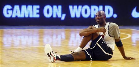 U.S. Olympic basketball player Kobe Bryant stretches during a training session at Palau Sant Jordi in Barcelona